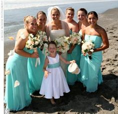 Jenni's five bridesmaids wore strapless, dropped-waist gowns in aqua chiffon by Jim Hjelm.