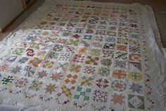 AngelaFMQ, via Flickr, you must look at this closely, truely a work of heart.  Check out the adorable and the spectacular quilting...