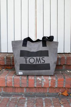 Transport everything you need in a simple grey canvas TOMS tote.