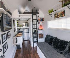 white beadboard interior with dark wood floor