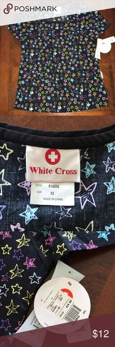 Scrub Top White Cross scrub top with multi-colored stars on it. Two pockets on the front. Never worn, ever. Perfect condition!!!! White Cross Tops