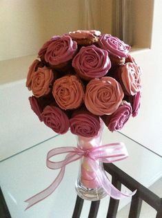 Cupcake bouquet http://thecupcakeblog.com/small-rose-mini-cupcake-bouquet/