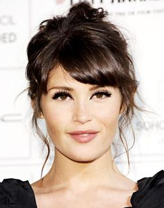 messy updo with flowing face framing layers and side swept bangs.This romantic hairstyle will be a perfect choice for Valentine's Day..