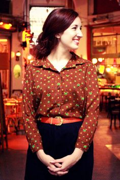 Vintage brown collar shirt with colorful pattern.