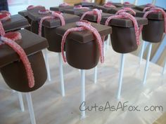 Graduation Marshmallow Pops - chocolate dipped marshmallows, chocolate squares, and sour ropes make a fun and delicious graduation treat.