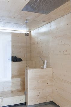 glass walled white sauna off shower