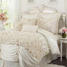 "Add feminine-chic flair to your master suite or guest bedroom with this faux silk comforter set, showcasing layers of ruched detailing and hand-sewn bows.   Product: Queen: 1 Comforter, 1 bed skirt, and 2 standard shamsKing: 1 Comforter, 1 bed skirt, and 2 king shamsCalifornia King: 1 Comforter, 1 bed skirt, and 2 king shamsConstruction Material: Faux silk and polyesterColor: IvoryFeatures:  Hand-sewn detailing14.5"" bed skirt drop lengthDimensions: Standard Sham: 20"" x 26"" Queen Comforter…"