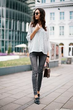 Grey skinny jeans with striped tunic top and pointed patent leather loafers.