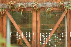 #Sundance Resort escort cards by Scenemakers. I like these colors and the flowers over the door are pretty.