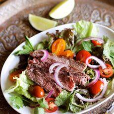 Thai Grilled Steak Salad Recipe Salads with rib eye steaks, lime juice, fish sauce, sugar, lettuce, mint leaves, coriander leaf, cherry tomatoes