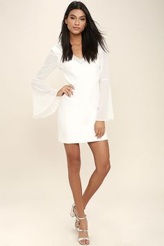We'd wait up all night just to catch a glimpse of the Leave the Light On White Beaded Long Sleeve Dress! Woven poly (with a bit of stretch) shapes a darted bodice and V-neckline trimmed with sparkling rhinestones and beads. Sheer bell sleeves and a sheath skirt complete this stunning dress. Hidden side zipper.