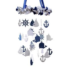Navy & Gray Nautical Mobile by Carousel Designs.  This adorable mobile will make the perfect addition for any nursery. Your baby will love watching these nautical shapes as they sway gently in the subtlest of air movement. Satin & organza ribbons in navy, gray & white adorn a hoop which gracefully suspends dozens of various nautical shapes in coordinating colors. The finishing touch is a length of the navy satin ribbon which you can use to hang from a ceiling hook.