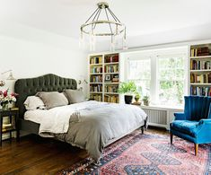 Love that it's not a huge room - bed, rug, chair. We can do this too. And the headboard is dreamy.