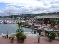 Knysna. A beautiful beach town to retire in on the Western Cape area of South Africa. The scenery is spectacular and the living inexpensive. http://www.topretirements.com/reviews/South%20Africa/Knysna.html
