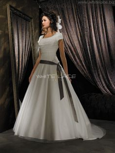 I love dresses with low sashes like this one.