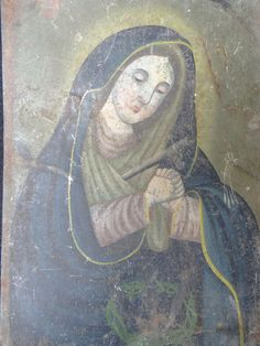 This beautiful antique Mexican painted tin retablo features the Madonna, Mary, Mother of Jesus Christ. Saint Mary has hands in the praying position
