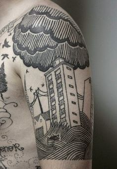 cloud tattoo on arm