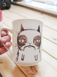 Grumpy cat mug...wonder if you could make this by drawing on it and baking the mug