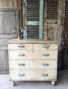 Lovely vintage French very rustic chest of drawers. A sturdy piece of furniture with original paint and original handles. Measures