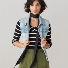 I love the denim vest and scarf paired with olive skirt and stripped shirt as a color block.