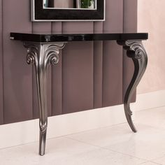 Elegant Contemporary Black Console shown here has a glossy black finish and a smoked glass top with baroque detailed legs finished in pewter. Available in alternative colours and finishes.