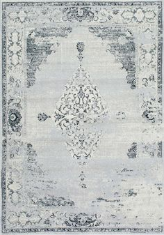 Give an abstract flair to your personal space with this plush machine-made rug. The polypropylene rug features an abstract pattern with hues of grey to make a great addition to any room.