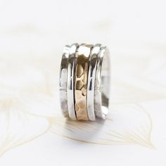Chunky Silver Spinning Ring with Brass par CharlottesWebEtsy
