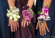 A corsage wristlet is usually pretty easy to slip over the wrist but if it is too loose it may need to be pinned. This is a guide about attaching a corsage to wristlet. Wristlet Corsage, Bracelet Corsage, Flower Bracelet, Prom Corsage And Boutonniere, Corsage Wedding, Bridal Bouquets, Boquet, Boutonnieres, Prom Flowers