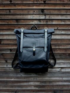 This backpack was made with black gride waxed canvas with an outside pocket made in black oiled leather.(due to taking the photos outside on some