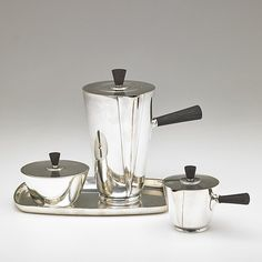 "C.C. HERMANN  Four-piece chocolate set: chocolate pot, tray, sugar pot, creamer, Denmark, 1950s; Sterling silver, ebony; All stamped C.C. HERMANN DENMARK STERLING, numbers; Chocolate pot: 7 3/4"" x 7"""