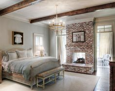 Bedroom with sitting room, brick fireplace, Velvety Vintage Rafter beams Chandelier Monochromatic Cream! :)