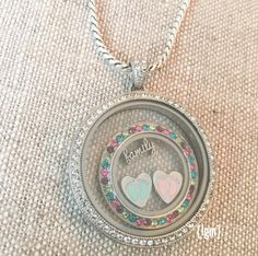 Legacy Locket with Large Multi-color crystal face  http://AshleyMarie89.OrigamiOwl.com