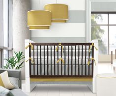 The sleek, modern and sophisticated bedding that will line Corryn's crib. Triple Band, by Oilo baby. Love it!