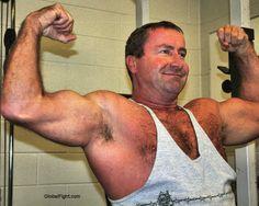 massive arms hairy daddybear flexed biceps