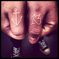 White Ink Anchor & Number Tattoo On Thumb | Tattoo Styles