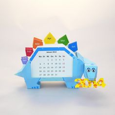 Papercraft Dino Calendar, free template. (Hopefully she'll add 2015 cards soon!)