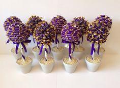 Cadbury purple and ivory Cadbury chocolate tree wedding centrepieces www.sweettreesessex.com