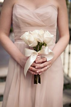 White rose bouquet for the bridesmaids, minus the ribbon. The stems will be wrapped in damask print.
