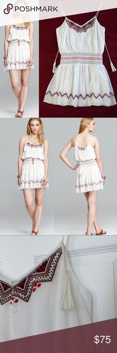 Free People Penny Georgette Love Bird boho Dress. Free People Penny Georgette Love Bird White boho dress.  ❌Imperfection: There is a tiny dark dot near the armhole / hanging front tassel.  Measurements: Armhole-to-Armhole: 37 1/2 Waist (not stretched): 29 1/2 Waist (stretched): 35 1/2 Side Seam:26 3/4 Full Hem Opening: 79 Details: Braided Spaghetti strap w/ hanging tassels. Decorative embroidery and beading. hook-and-eye closures. Smocked Elastic waist. Lined. Chiffon. Shell: 100% Polyester…
