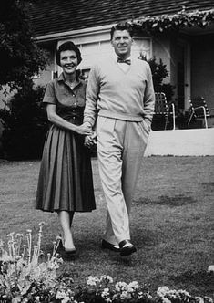 Ronald Reagan with wife Nancy at home.