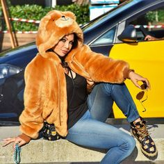 How cute! Haifa Wehbe in Moschino teddy bear hoodie, bag and lace-up boots. Street Style.