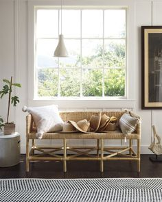 This rattan bench in this cali boho modern living room is aces