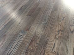 Red oak with driftwood stain. Gorgeous. Floors
