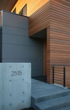 hardiboard fence and paint color Magnolia House - modern - Entry - Seattle - ALCOVA architecture House Cladding, Wood Cladding, Exterior Cladding, House Siding, Wood Siding, Cement Board Siding, Gray Siding, Shiplap Siding, Modern Entry