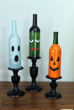 Halloween wine bottle décor. Create your own little monster bottles by recycling empty wine bottles. You could also make smaller versions using wine cooler bottles. - Pam