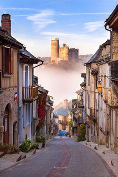 Misty road to Najac castle, France