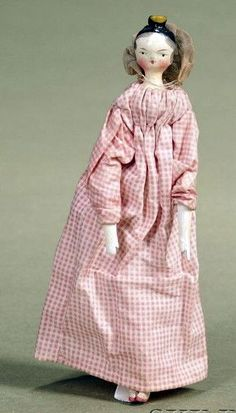 Grodnertal Doll, c. 1820 wearing pink checked cotton dress and bonnet,