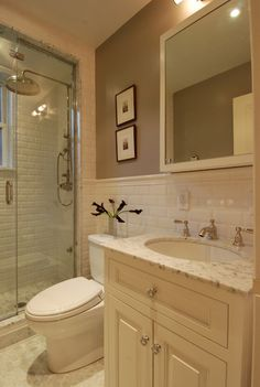 The Renovated Home - bathrooms - cream vanity, cream sink vanity, cream raised front cabinets, cream raised door fronts, polished nickel hardware, marble counters, marble countertops, oval shaped sink, oval shaped porcelain