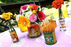 I like how they use cans and bottles for the flowers. Wonder where I could find some of those.....