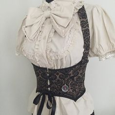 This steampunk style corset will be made custom to your measurements (see below for size limits), out of a cotton damask print fabric which has